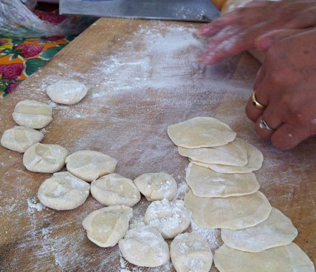 Tian Yali rolling out dumpling wrappers.