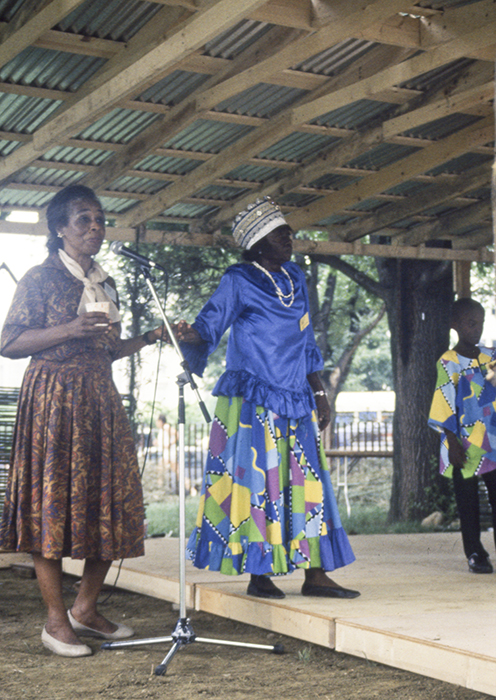 "Olive Lewin moderates a session featuring a Kumina band from Jamaica, with Imogene ""Queenie"" Kennedy (right) at the 1989 Smithsonian Folklife Festival program The Caribbean: Cultural Encounters in the New World. Ralph Rinzler Folklife Archives and Collections, Smithsonian Institution"