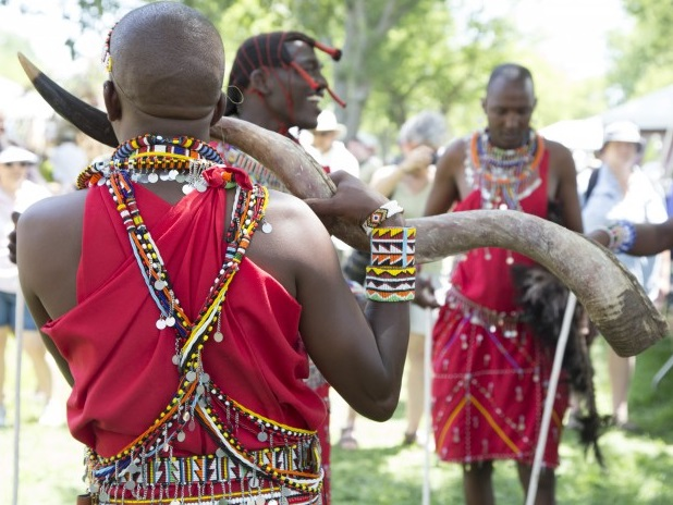 Masaai horn player and dancers.