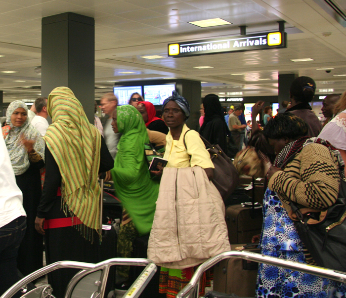 A group of around forty Kenyans arriving at Dulles airport, and my first experience as a travel aid.