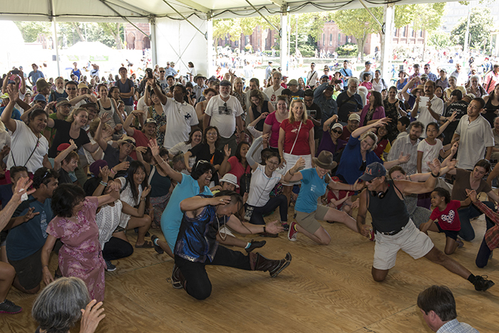 Festival visitors dance with Ih Tsetsn singer and qobuz player Dabuxilatu during a performance at the Moonrise Pavilion.