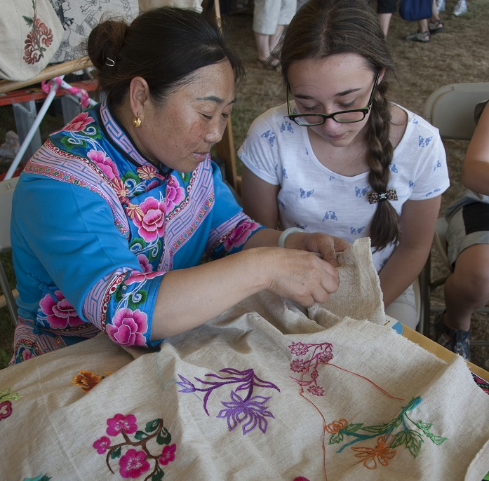 Li Xingxiu demonstrates her craft to a Festival visitor. Photo by Michelle Albeit, Ralph Rinzler Folklife Archives