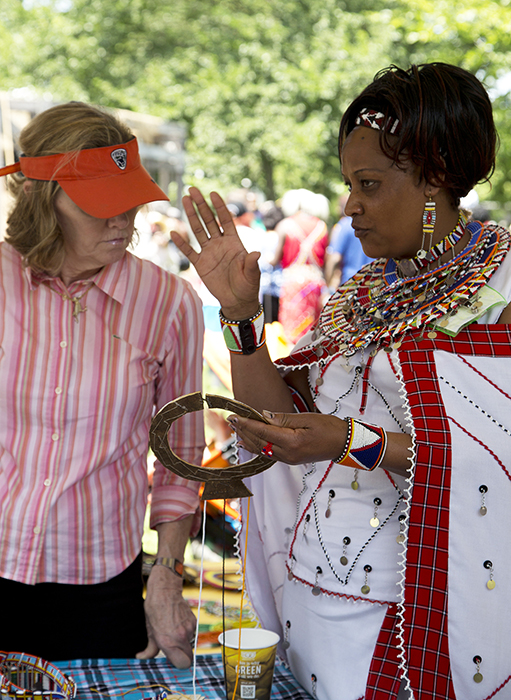 Susan Naserian Nketoria explains her beadwork to a visitor.