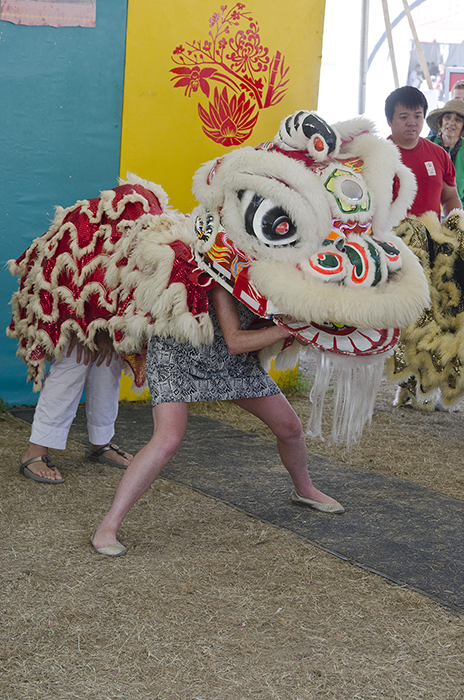 Dragon dancing in the Family Style activities tent.