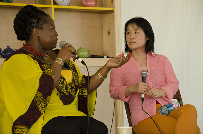 Performers Iddi Achieng' and Wu Man in a cross-program  discussion on women and music in Teahouse Commons.