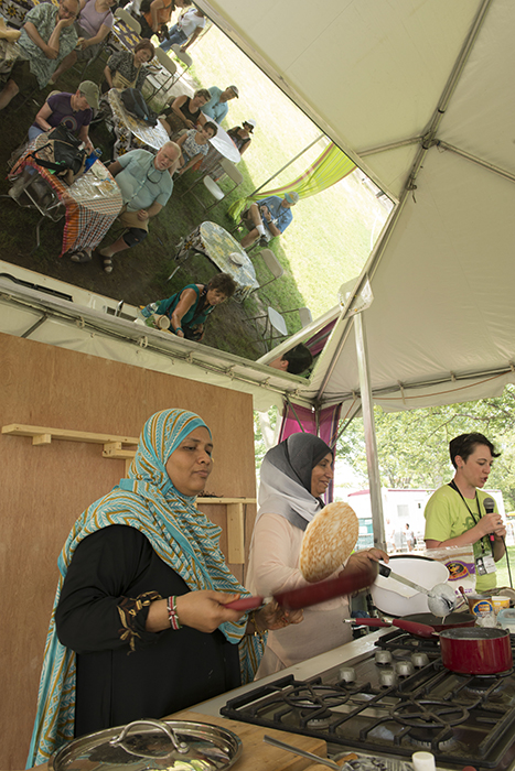 Preparing chapati in Flavors of Kenya foodways demonstration tent.
