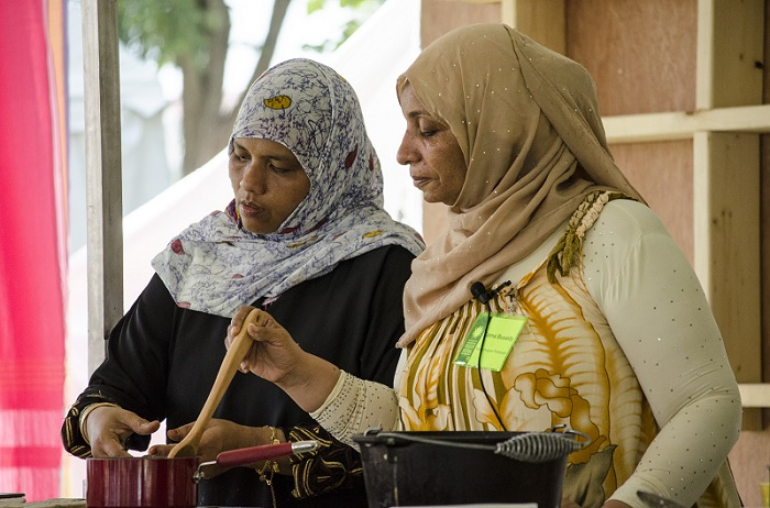 Amina Harith Swaleh and Fatma Ali Busaidy in the Flavors of Kenya kitchen. Photo by Kate Mankowski, Ralph Rinzler Folklife Archives and Collections, Smithsonian Institution