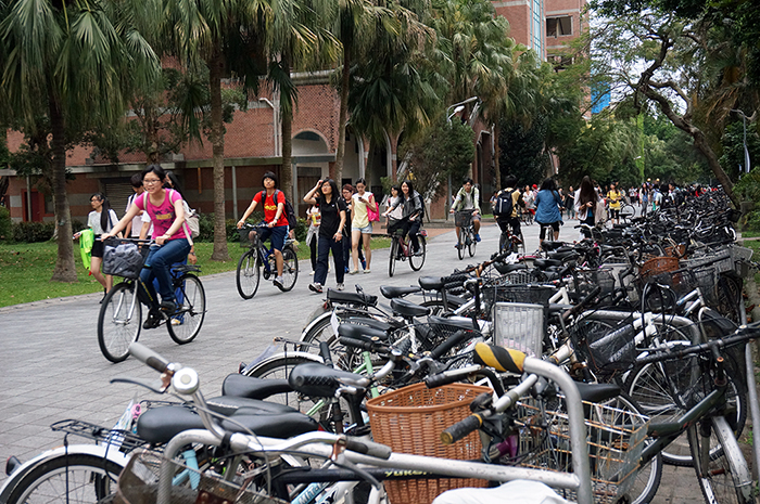 Students pass by a bike rack at the National Taiwan University in Taipei, which is known to be a bike-friendly campus.