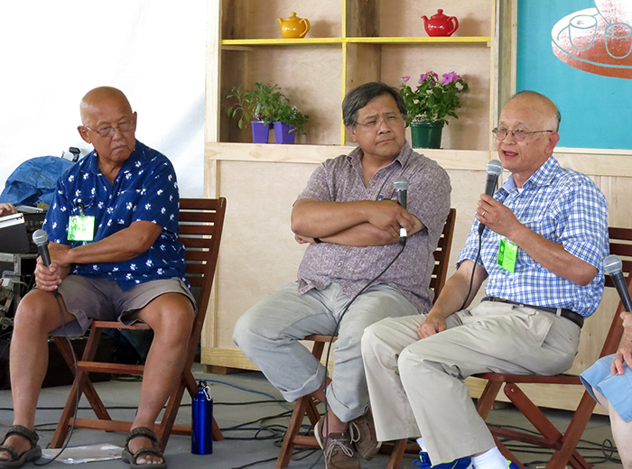 Stan Lou, Ted Gong, and Walter Woo in the Teahouse Commons at the 2014 Smithsonian Folklife Festival. Photo by Sojin Kim