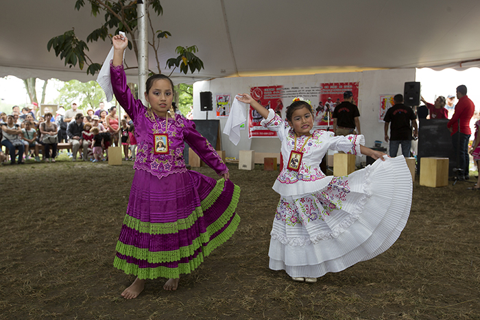 The young students of the Centro Cultural Perú in Virginia showed off the Marinera dance steps they have learned and invited visitors to the Wawawasi Kids Corners to try for themselves. Photo by Francisco Guerra, Ralph Rinzler Folklife Archives