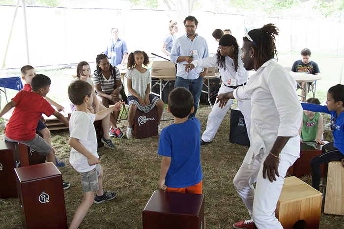 The Afro-Peruvian group Tutuma leads a cajón workshop for children at the Wawawasi Kids Corner. Photo by Rori Smith, Ralph Rinzler Folklife Archives