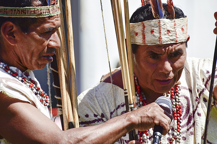 The Wachiperi people of the Peruvian Amazon retain many traditional ways of life, such as wearing clothing made of tree bark and using bows and arrows to hunt. On the Mall, they are demonstrating their archery skills. Photo by Ronald Villasante, Ralph Rinzler Folklife Archives