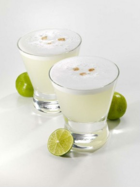Pisco sour, Peru's national drink, is made with lime, egg whites, gum syrup, and pisco. Photo courtesy of Flickr user Thomas S.