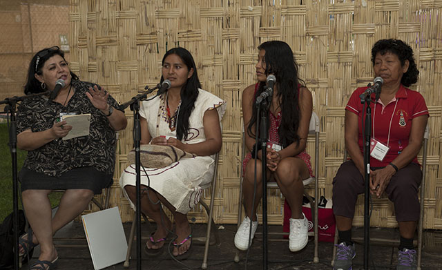 At El Hablador, Wachiperi scholar Nely Margot Ninantay Yonaje (second from left) shared her community's efforts to preserve their language with Danna Gaviota Tello Morey and María Nieves Nashnato Upari from Radio Ucamara. Photo by Brian Barger, Ralph Rinlzer Folklife Archives