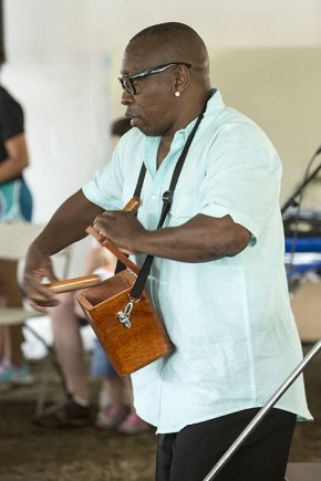 "As part of Festival Community Day, Freddy ""Huevito"" Lobotón demonstrated how to play the cajita, a percussion instrument inspired by church collected boxes. Photo by Micheal Barnes, Ralph Rinzler Folklife Archives"