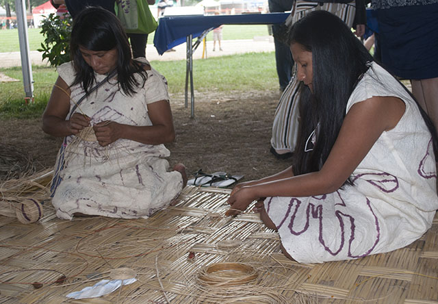 Sofía Solisonquehua Untamay and Odette Marlid Ramos Dumas demonstrated Wachiperi basket weaving traditions at the Festival. Photo by J.B. Weilepp, Ralph Rinzler Folklife Archives