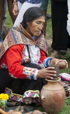 Quintina Huanca Quispe prepares the chicha. Photo by Kadi Levo, Ralph Rinzler Folklife Archives