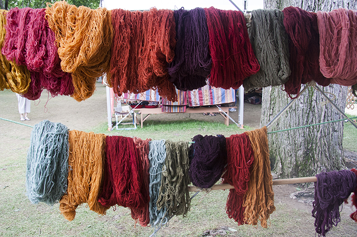 The weavers from the Centro de Textiles Tradicionales del Cusco use natural plant dyes to color their hand spun wool. Photo by Kadi Levo, Ralph Rinzler Folklife Archives
