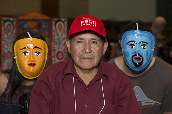 Germán Nilo Prado gave a talk about his masks in the Festival Marketplace, where visitors can also purchase masks to take home! Photo by Pruitt Allen, Ralph Rinzler Folklife Archives
