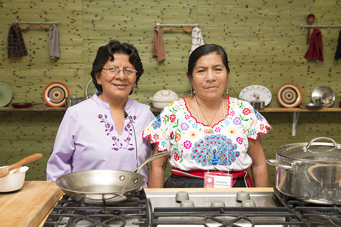 Manuela Ayasta and Margarita Guzmán demonstrated how to cook garbanzos norteños, a traditional dish from Monsefú. Photo by Pruitt Allen, Ralph Rinzler Folklife Archives