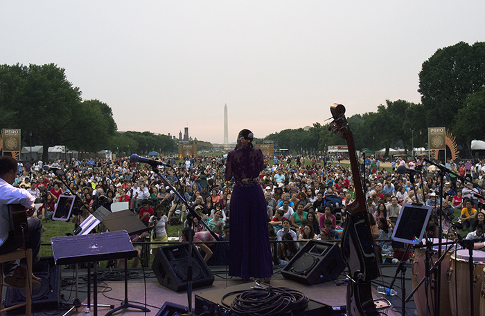 Julie Freundt performs with Marinera Viva!!! on the Ralph Rinzler Concert Stage, with the Q'eswachaka Bridge in the background. Photo by Ronald Villasante, Ralph Rinzler Folklife Archives
