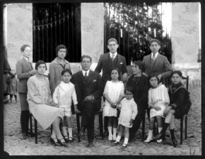 Lucho Valencia's grandfather (seated) with his family in Arequipa. Lucho's father, Manuel Valencia, is in white to his right. Photo courtesy of Cecilia Peterson