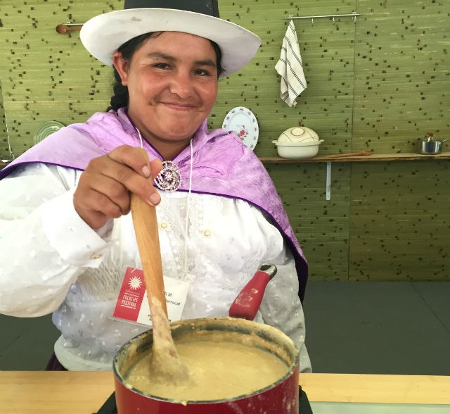 Ana María Ccahuin Berrocal, from the La Chacra: Quinoa Farming group, prepared <em>mazamorra de quinua</em> at the Folklife Fesival. Photo by Erin Kurvers