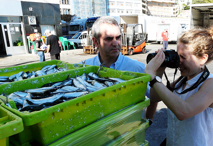 Shooting sardines at the harbor in Ondarroa, Bizkaia, with Asier Madarieta Juaristi, Managing Director of BizkaiKOA. Photo by Mary Linn, Ralph Rinzler Folklife Archives