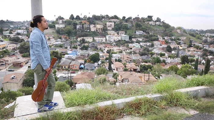 César Castro overlooks El Sereno, California. Still from video by Akira Boch