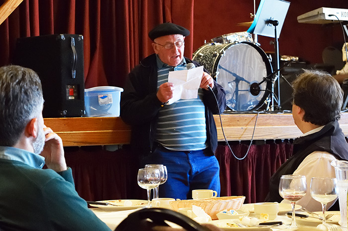 Johnny Curutchet sings a pre-written song with an assigned subject after lunch at the San Francisco Basque Cultural Center. Photo by Greyson Harris, Ralph Rinzler Folklife Archives