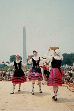 Members of the Oinkari Basque Dance troupe, dance on the National Mall in front of the George Washington Monument. Photo by ??
