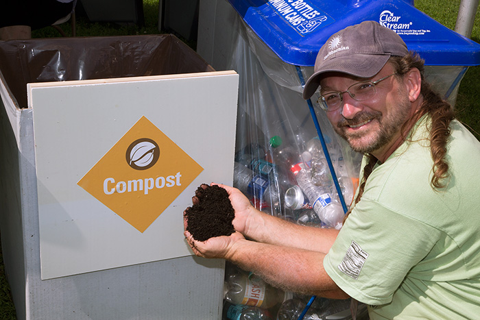 Eric Hollinger shows off a handful of compost, easily produced from food waste. Photo by Francisco Guerra, Ralph Rinzler Folklife Archives