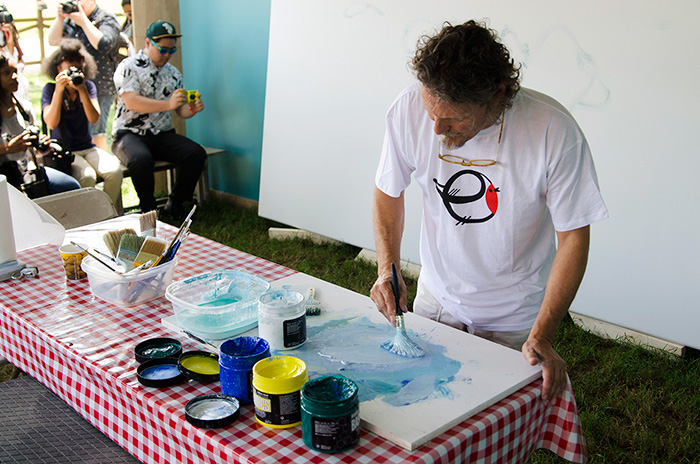 Jesus Mari Lazkano is a renowned landscape painter from the Basque country. Over the course of the Festival, he is painting two eighteen-foot canvases of expansive seascapes. Photo by Josh Weilepp, Ralph Rinzler Folklife Archives