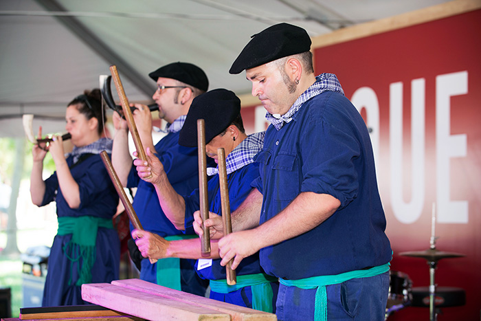 Members of the group Klaperttaŕak led a <em>txalaparta</em> workshop in the morning, showing off the Basque instrument made from wooden cider making parts, similar to a xylophone. Photo by Walter Larrimore, Ralph Rinzler Folklife Archives