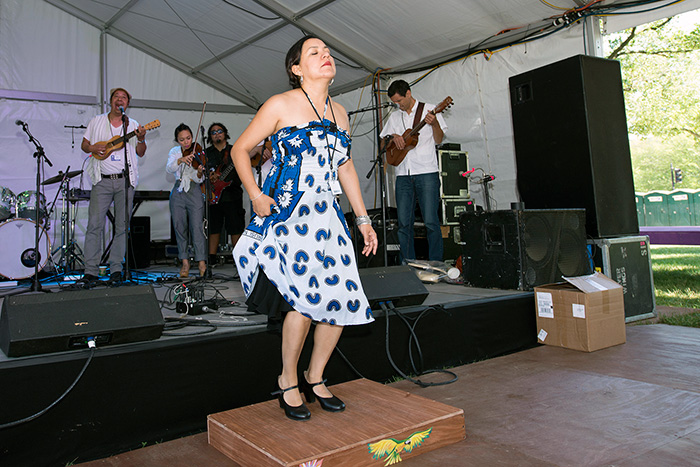 Martha Gonzalez is doing double-duty during the Folklife Festival, playing with the band Quetzal and with the FandangObon group. Today she danced on the tarima platform with her son jarocho group. You can find them each day at the Sounds of California Stage & Plaza. Photo by Walter Larrimore, Ralph Rinzler Folklife Archives