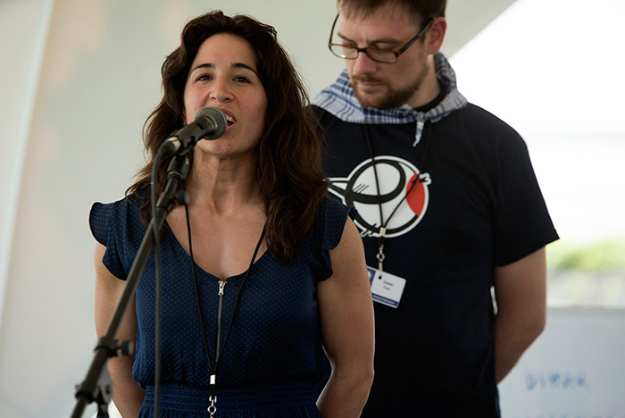 "Irati Anda and Xabier Paya are bertsolariak, Basque poets who improvise songs on given topics. In today's ""Berto Workshop,"" they sang about arriving in Washington, their favorite sports, and Xabi's amuma (grandmother). Photo by Maureen Spagnolo, Ralph Rinzler Folklife Archives"