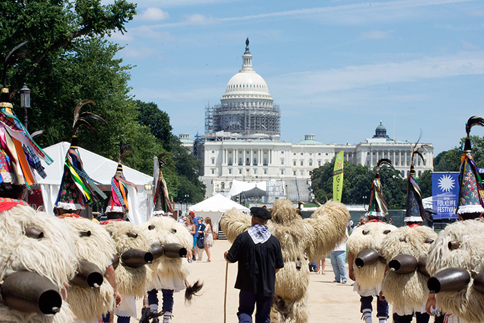 The Joaldunak practice a ritual procession in elaborate costumes: sheep skins, cone-shaped hats decorated with ribbons, and large—very loud—bells on their backs. Each afternoon through July 4, they will lead a parade around the National Mall. Photo by Ronald Villasante, Ralph Rinzler Folklife Archives