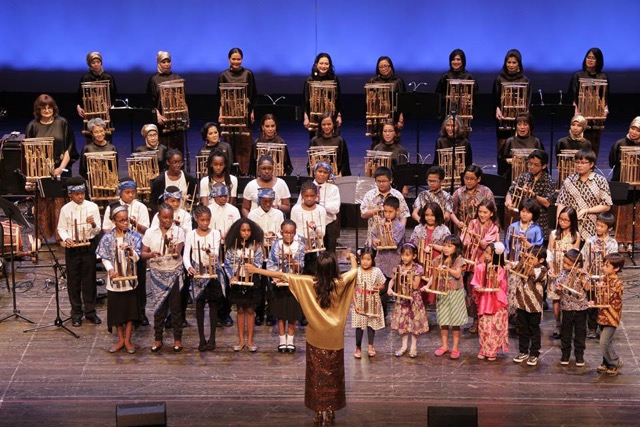Rumah Indonesia teaches students to play the <em>angklung</em>, a bamboo rattle. Each instrument only plays one note, but played together in a group they can create melodies. Photo courtesy of Rumah Indonesia