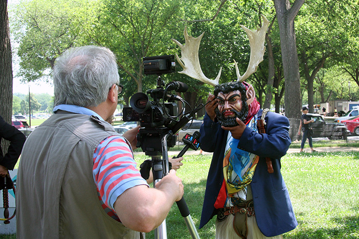 A film crew from Voice of America interviewed a member of Grupo Nuu Yuku in between devil dances. Photo by Elisa Hough, Ralph Rinzler Folklife Archives