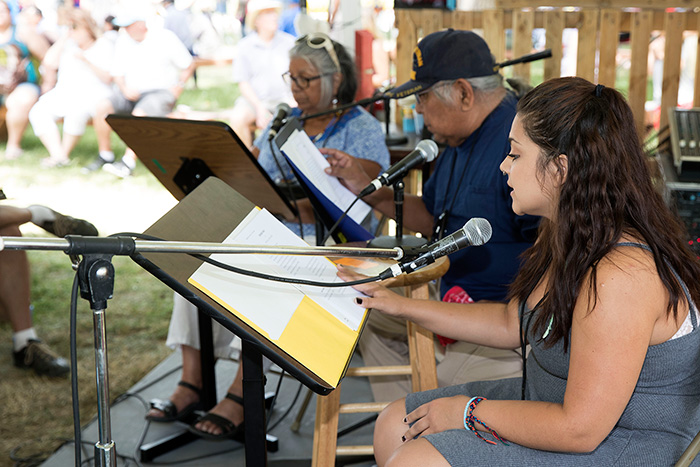 Helena and Preston Arrow-weed, accompanied by Maricella Rodriguez, present a radio drama that Preston is developing. Photo by Francisco Guerra, Ralph Rinzler Folklife Archives
