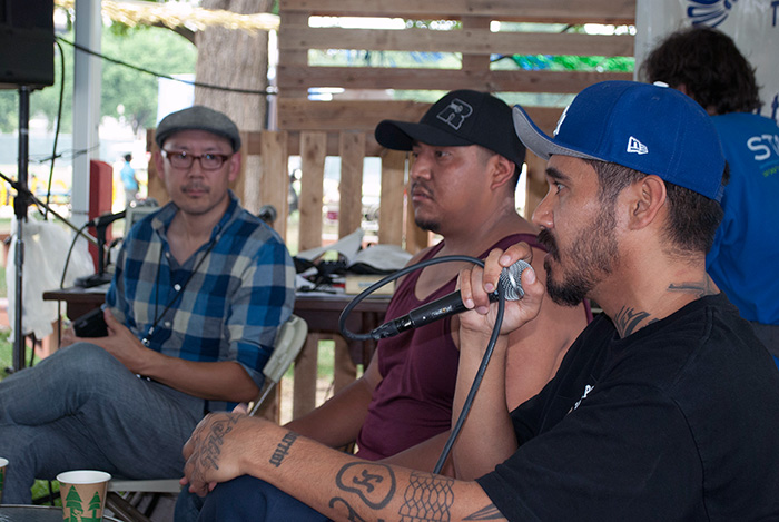 Music journalist Oliver Wang (left) interviewed Ray Guzmán (part of Grupo Nuu Yuku) and Bambu (right) about their individual experiences growing up with hip-hop and starting to rap in The Studio. Photo by J.B. Weilepp, Ralph Rinzler Folklife Archives