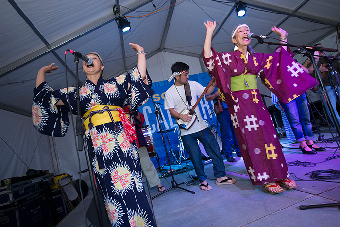 <em>FandangObon</em> gave their last Folklife Festival performances today, with Nancy Sekizawa and Nobuko Miyamoto leading the singing and dancing. Tomorrow they head back to Los Angeles. Photo by Walter Larrimore, Ralph Rinzler Folklife Archives