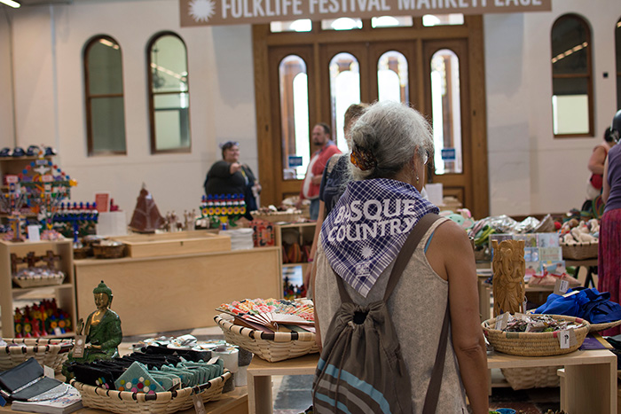 This is the first year the Festival Marketplace has been inside the Arts and Industries Building, which has been shuttered for twelve years. Inside you'll find crafts by Basque and Californian artists, plus merchandise from past Festivals. Photo by Olivia Boyle, Ralph Rinzler Folklife Archives