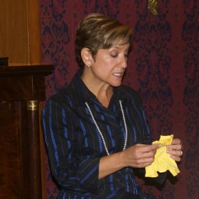Mariela Melero shares the story of the doll she and her sister had to leave behind when they traveled to the United States from Cuba. She donated the doll's tiny yellow shirt to the Smithsonian. Photo courtesy of Mariela Melero