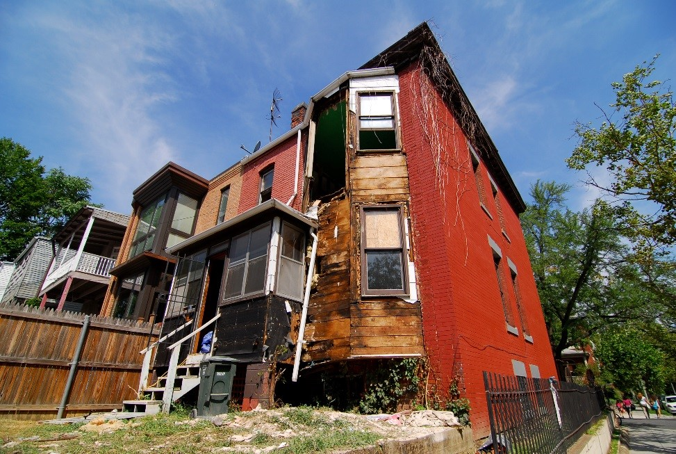 Rehabilitation: sample of decrepit housing in Columbia Heights that is slated for remodeling. Photo by Fernando C. Sandoval, Oak Street Studio