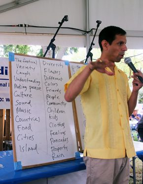 Quetzal Flores helps collect words from the audience. Photo by Ying Diao srcset=