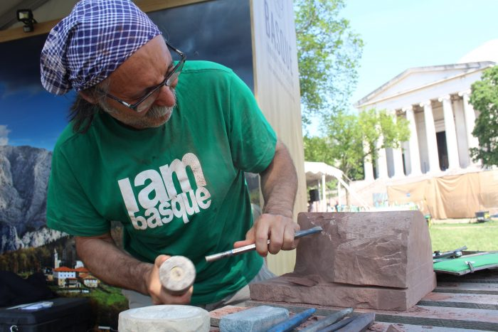 Bernat carving the carvel that he has given to the Smithsonian, on the National Mall at the 2016 Smithsonian Folklife Festival. Photo by SarahVictoria Rosemann