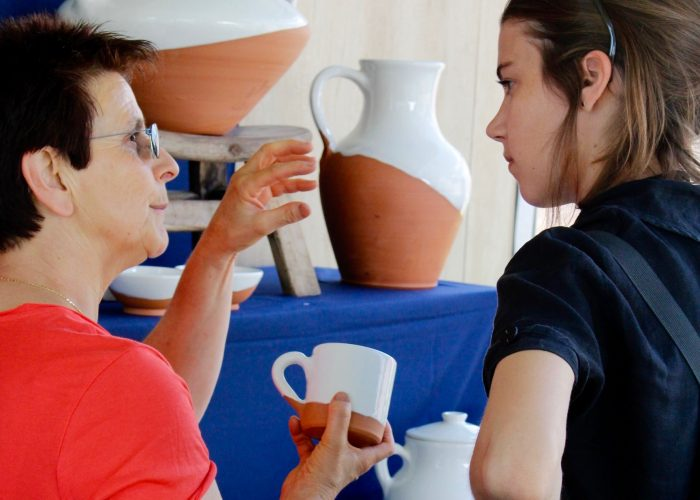 Blanka explaining an aspect of Basque pottery to Basque program intern Grace Caroll. Photo by SarahVictoria Rosemann