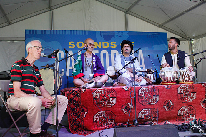 George Abe joins Afghan American musicians Homayoun Sakhi (middle) and Salar Nader (right) in a discussion on musical resilience despite war, exile, and displacement, moderated by ethnomusicologist Theodore Levin. Photo by SarahVictoria Rosemann