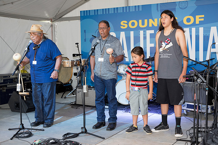 Preston Arrow-weed, Stan Rodriguez, Hwaa Hawk, and Raymond Martinez collaborate on sharing Native California song traditions. Photo by Francisco Guerra, Ralph Rinzler Folklife Archives
